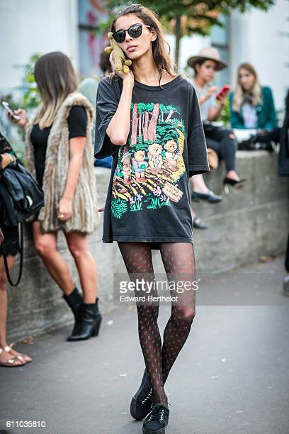 A guest is seen outside the Rochas show at the Palais de Tokyo during Paris Fashion Week Spring Summer 2017 on September 28 2016 in Paris France