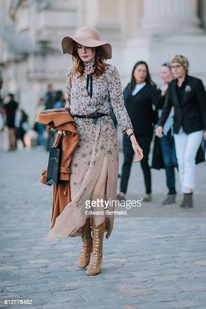 A guest is seen outside the Shiatzy Chen show during Paris Fashion Week Spring Summer 2017 at Grand Palais on October 4 2016 in Paris France