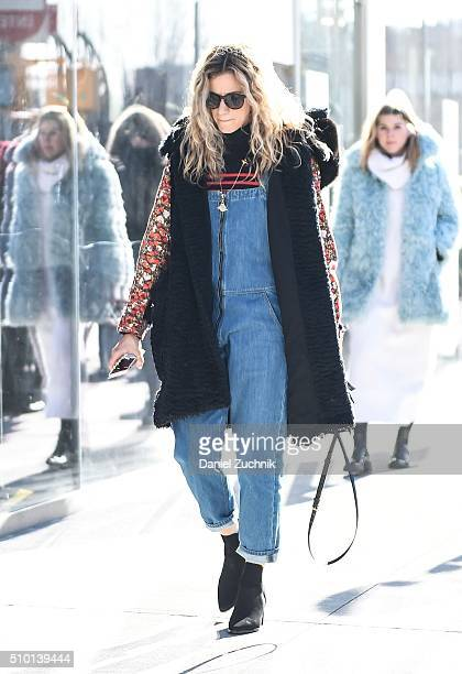 A guest is seen outside the Tibi show wearing a blue jeans one piece jumper during New York Fashion Week Women's Fall/Winter 2016 on February 13 2016...