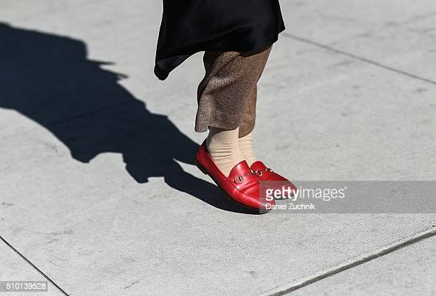 A guest is seen outside the Tibi show wearing red flats during New York Fashion Week Women's Fall/Winter 2016 on February 13 2016 in New York City