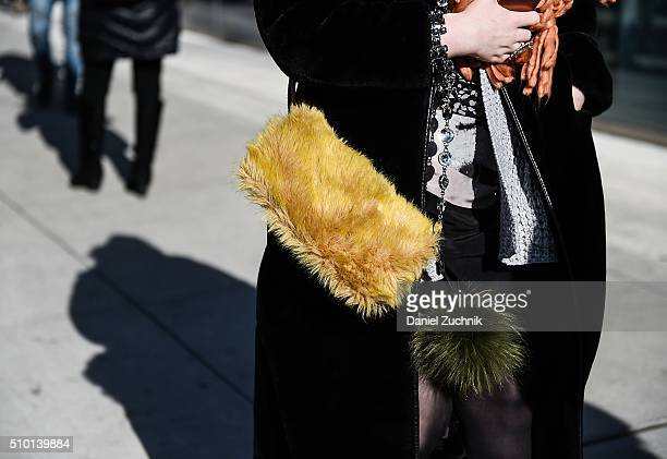 A guest is seen outside the Tibi show with a yellow fur purse during New York Fashion Week Women's Fall/Winter 2016 on February 13 2016 in New York...