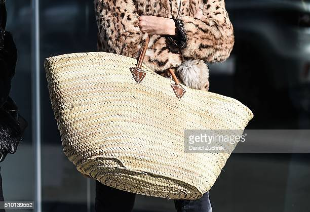 A guest is seen outside the Tibi show with an oversized straw bag during New York Fashion Week Women's Fall/Winter 2016 on February 13 2016 in New...