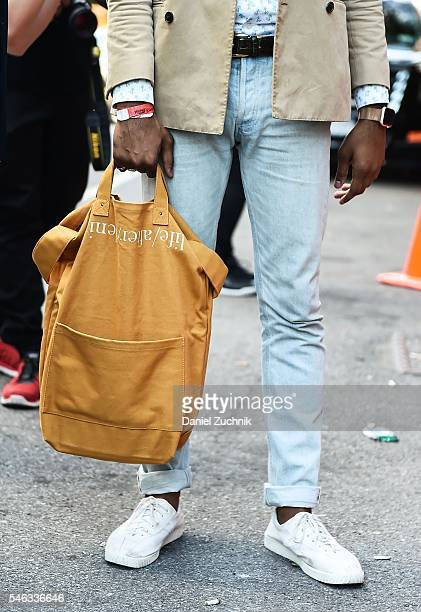 A guest is seen outside the Uri Minkoff show with a beige backpack during New York Fashion Week Men's S/S 2017 Day 1 on July 11 2016 in New York City