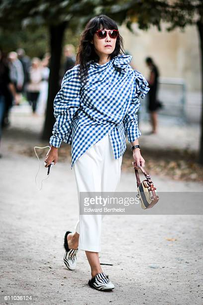 A guest is seen outside the Yang Li show during Paris Fashion Week Spring Summer 2017 on September 28 2016 in Paris France