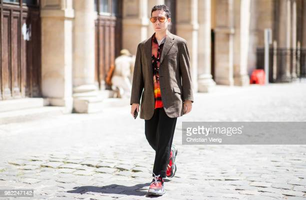 A guest is seen outside Thom Browne on day five of Paris Fashion Week Menswear SS19 on June 23 2018 in Paris France