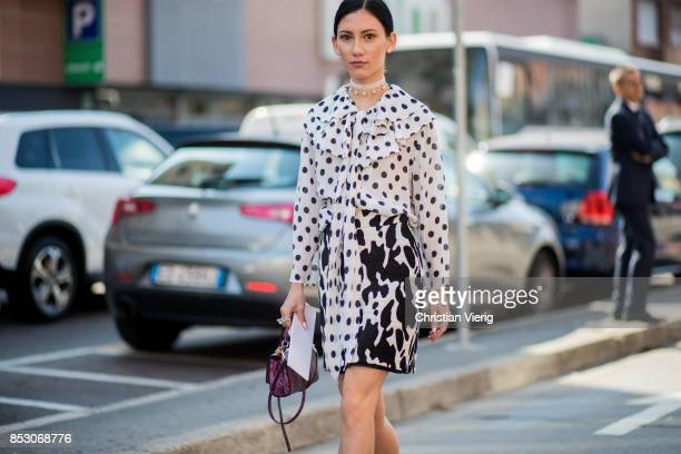 A guest is seen outside Trussardi during Milan Fashion Week Spring/Summer 2018 on September 24 2017 in Milan Italy