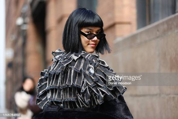 Guest is seen posing outside of Spring Studios during New York Fashion Week on February 09, 2020 in New York City.