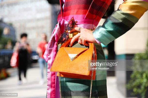 Guest is seen posing with accessories at Spring Studios during New York Fashion Week on September 11, 2019 in New York City.
