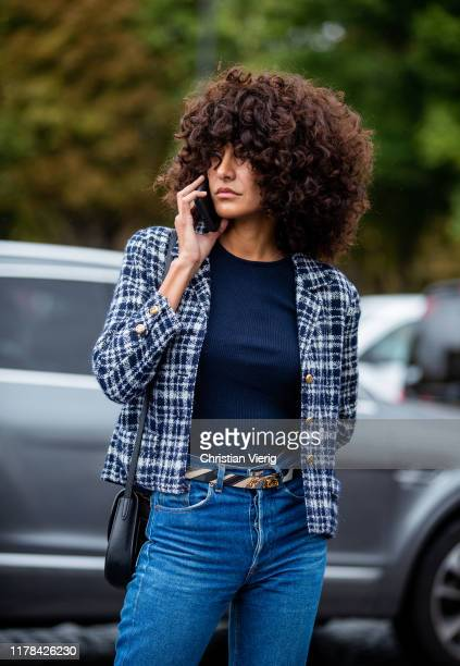 Guest is seen talking on the phone outside Chanel during Paris Fashion Week Womenswear Spring Summer 2020 on October 01, 2019 in Paris, France.