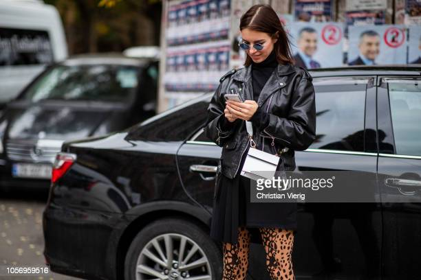 A guest is seen weaaring tights with print black leather jacket during MercedesBenz Tbilisi Fashion Week on November 3 2018 in Tbilisi Georgia