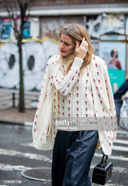 Guest is seen weairng cardigan outside Gabriela Hearst during New York Fashion Week Fall / Winter on February 11, 2020 in New York City.
