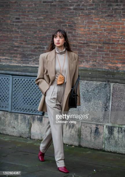 Guest is seen weairng micro bag around her neck, beige blazer outside Lovechild on Day 1 during Copenhagen Fashion Week Autumn/Winter 2020 on January...