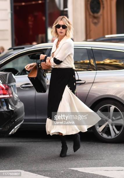 Guest is seen wearing a Balmain dress outside the Balmain show during Paris Fashion Week SS20 on September 27, 2019 in Paris, France.