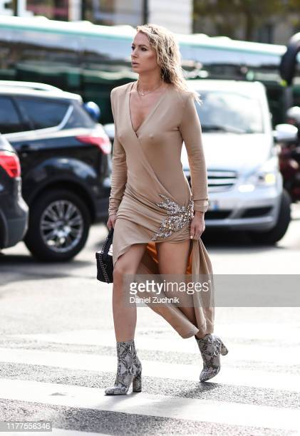 Guest is seen wearing a Balmian dress outside the Balmain show during Paris Fashion Week SS20 on September 27, 2019 in Paris, France.