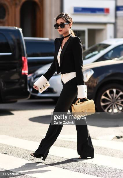 A guest is seen wearing a Balmian suit outside the Balmain show during Paris Fashion Week SS20 on September 27 2019 in Paris France