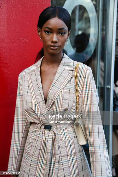 Guest is seen wearing a beige jacket at the Rebecca Minkoff show during New York Fashion Week on February 08, 2020 in New York City.