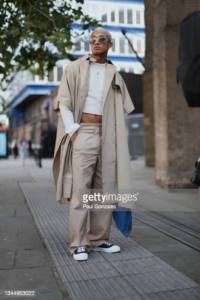 Guest is seen wearing a Beige Mac at COS during London Fashion Week September 2021 on September 21, 2021 in London, England.