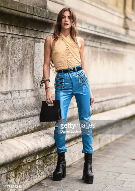 A guest is seen wearing a beige top blue biker pants and a black bag outside the Unravel show during Paris Fashion Week SS20 on September 25 2019 in...