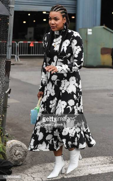 A guest is seen wearing a black and white floral dress outside the Brandon Maxwell show during New York Fashion Week Women's S/S 2019 on September 8...