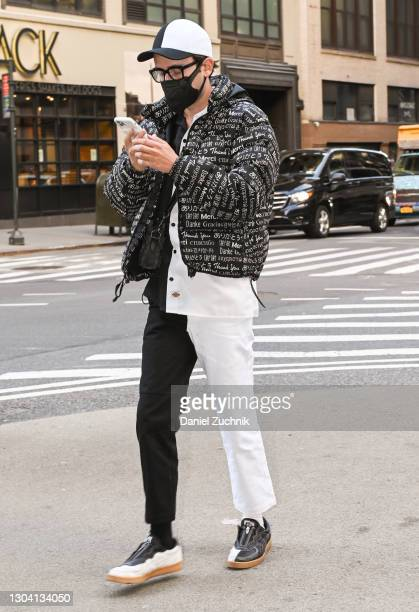 Guest is seen wearing a black and white outfit outside the Christian Siriano show during New York Fashion Week F/W21 on February 25, 2021 in New York...