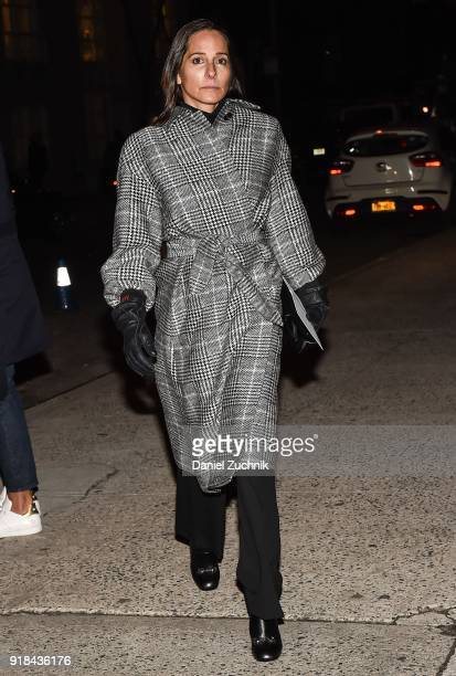 A guest is seen wearing a black and white plaid coat outside the Marc Jacobs show during New York Fashion Week Women's A/W 2018 on February 14 2018...