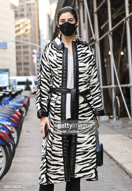 Guest is seen wearing a black and white zebra print coat outside the Christian Siriano show during New York Fashion Week F/W21 on February 25, 2021...