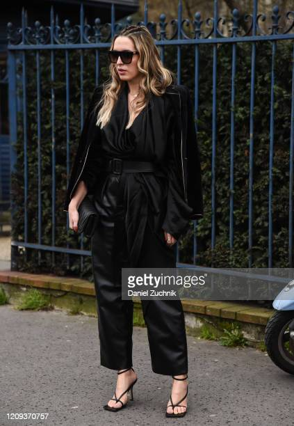 A guest is seen wearing a black Balmain outfit outside the Balmain show during Paris Fashion Week AW20 on February 28 2020 in Paris France