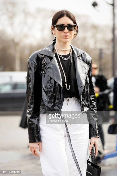 Guest is seen wearing a black Chanel jacket and white pants with sunglasses outside Paris Fashion Week Womenswear Fall/Winter 2020/2021 Day Nine on...