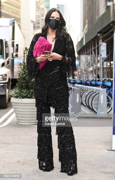 Guest is seen wearing a black Christian Siriano outfit and pink bag outside the Christian Siriano show during New York Fashion Week F/W21 on February...