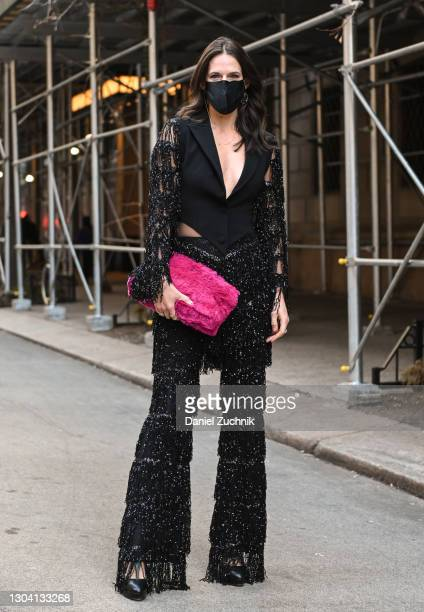Guest is seen wearing a black Christian Siriano outfit and pink outside the Christian Siriano show during New York Fashion Week F/W21 on February 25,...