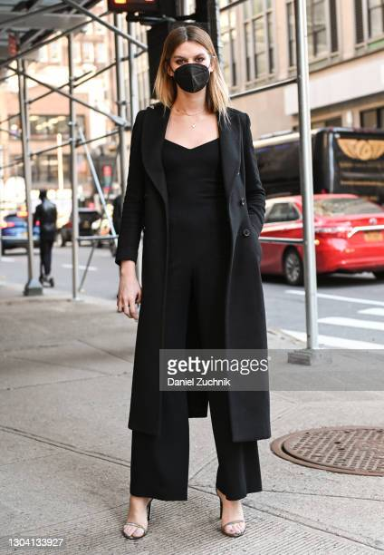 Guest is seen wearing a black coat and black one piece outfit outside the Christian Siriano show during New York Fashion Week F/W21 on February 25,...