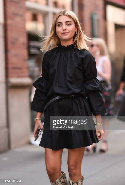 Guest is seen wearing a black dress outside the Cynthia Rowley show during New York Fashion Week S/S20 on September 10, 2019 in New York City.