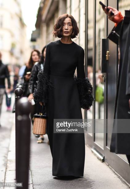 Guest is seen wearing a black dress outside the Thom Browne show during Paris Fashion Week SS20 on September 29, 2019 in Paris, France.