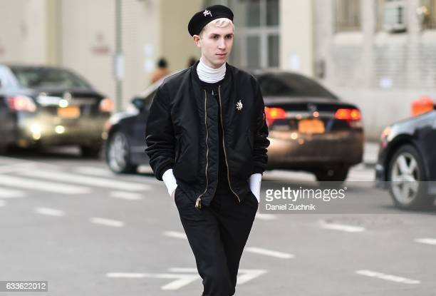 A guest is seen wearing a black jacket black pants and black beret outside of the General Idea show during New York Fashion Week Men's AW17 on...