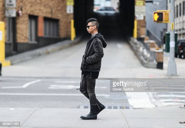 A guest is seen wearing a black jacket black pants and black boots outside of the STAMPD show during New York Fashion Week Men's AW17 on February 2...