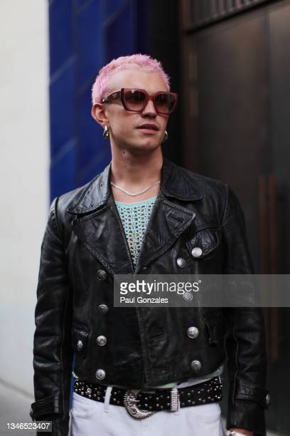 Guest is seen wearing a Black Leather Jacket with a Pair of Pastel Prada Glasses at Richard Quinn, during London Fashion Week September 2021 on...