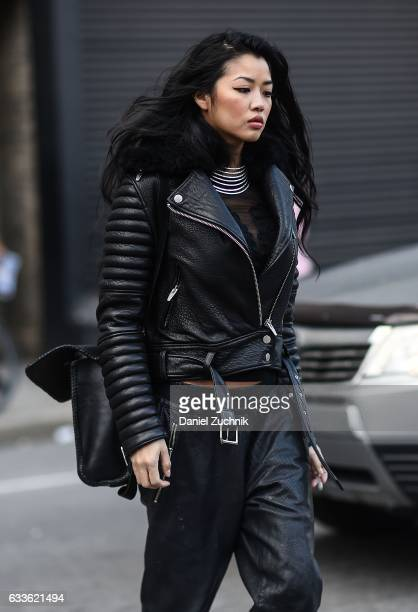 A guest is seen wearing a black leather jacket with leather pants outside of the STAMPD show during New York Fashion Week Men's AW17 on February 2...