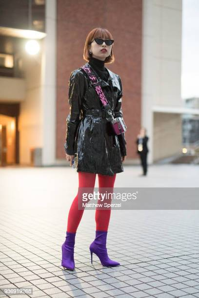 A guest is seen wearing a black nylon jacket red tights and purple shoes during the Amazon Fashion Week TOKYO 2018 A/W on March 22 2018 in Tokyo Japan