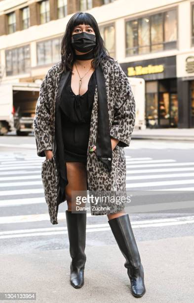 Guest is seen wearing a black outfit, animal print coat and black boots outside the Christian Siriano show during New York Fashion Week F/W21 on...