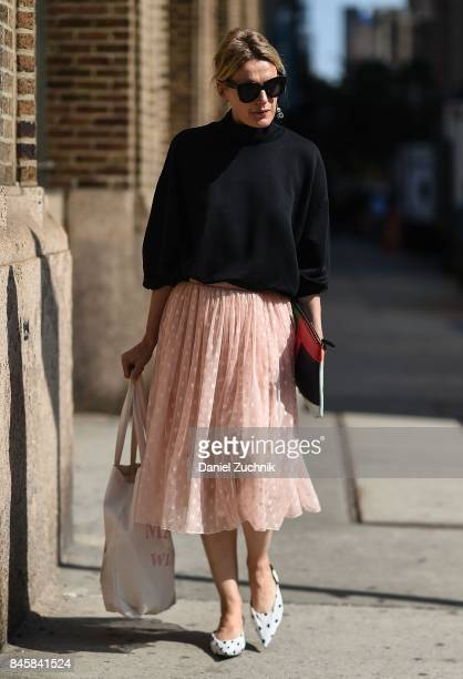 A guest is seen wearing a black sweater and pink skirt outside the Zadig and Voltaire show during New York Fashion Week Women's S/S 2018 on September...