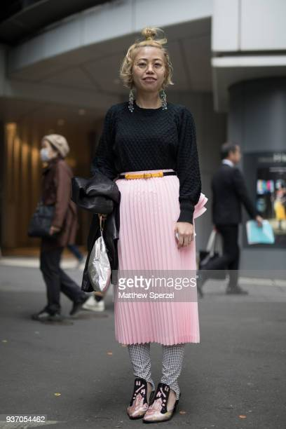 A guest is seen wearing a black sweater pink skirt and satin shoes during the Amazon Fashion Week TOKYO 2018 A/W on March 23 2018 in Tokyo Japan