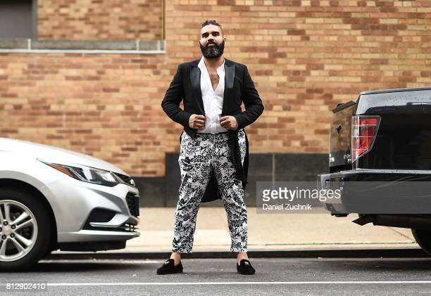 Guest is seen wearing a black tux jacket, white shirt and black and white floral pants outside the Carlos Campos show during New York Fashion Week:...