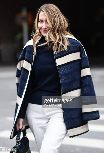 A guest is seen wearing a blue and white striped jacket blue sweater and white pants outside of the Nautica show during New York Fashion Week Men's...