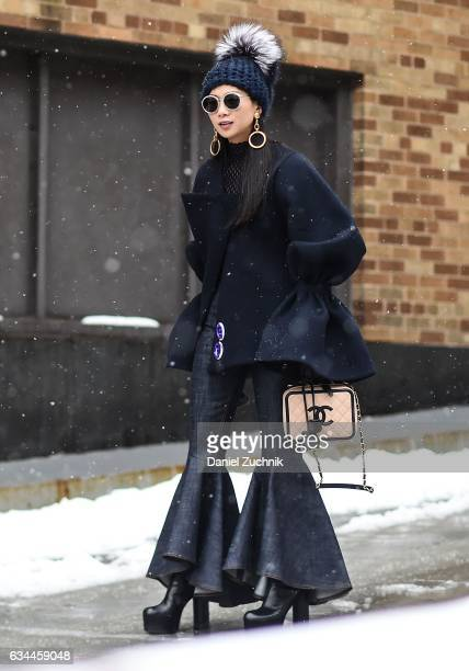 A guest is seen wearing a blue Chanel outfit outside of the Brock Collection show during New York Fashion Week Women's Fall/Winter 2017 on February 9...