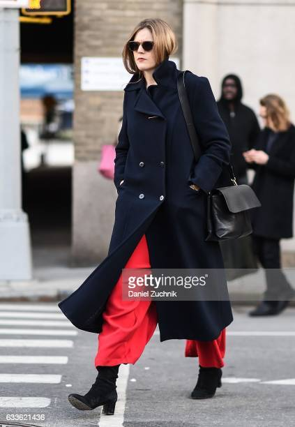 A guest is seen wearing a blue coat and red pants outside of the STAMPD show during New York Fashion Week Men's AW17 on February 2 2017 in New York...