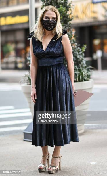 Guest is seen wearing a blue dress outside the Christian Siriano show during New York Fashion Week F/W21 on February 25, 2021 in New York City.