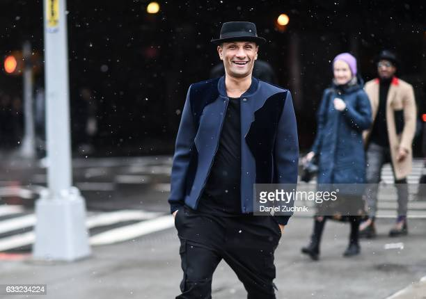 A guest is seen wearing a blue jacket black pants and black hat outside of the Carlos Campos show during New York Fashion Week Men's AW17 on January...