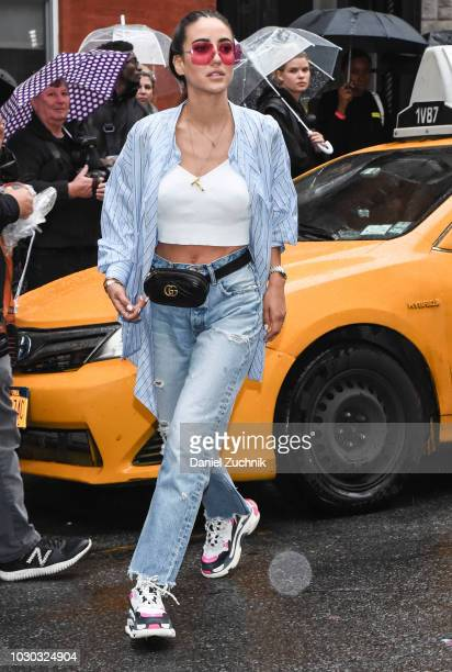A guest is seen wearing a blue striped shirt white top and blue jeans outside the Rodarte show during New York Fashion Week Women's S/S 2019 on...