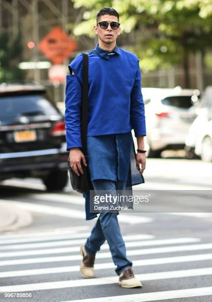 Guest is seen wearing a blue top and pants outside the Death to Tennis show during the 2018 New York City Men's Fashion Week on July 11, 2018 in New...