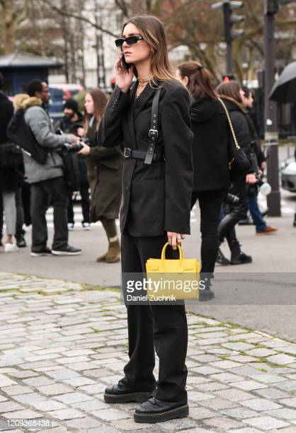 Guest is seen wearing a brown Balmain suit outside the Balmain show during Paris Fashion Week: AW20 on February 28, 2020 in Paris, France.